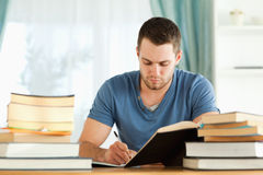 Student doing his homework. Male student doing his homework in his house Stock Images