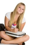 Student Doing Homework. Smiling teen student doing homework royalty free stock photography