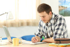 Student doing homework in a desk Royalty Free Stock Photography