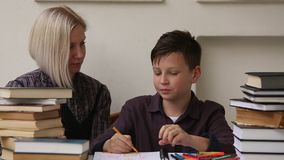 Student doing homework with the help of a tutor. stock video footage