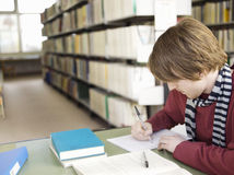 Student Doing Homework In Library Royalty Free Stock Images