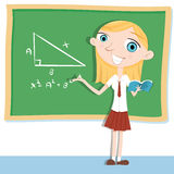 Student doing math  on chalkboard. Royalty Free Stock Image