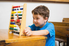 Student doing maths on abacus Stock Photography