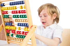 Student doing maths on abacus Royalty Free Stock Photography