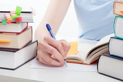 Student doing the notes. Student reading a book and writing the notes Stock Images