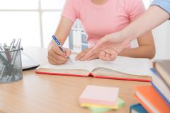 Student doing school homework with home tutor. Student doing school studying homework with home tutor royalty free stock image