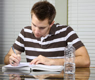 Student doing work Stock Images
