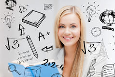 Student with doodles reading book Stock Photo