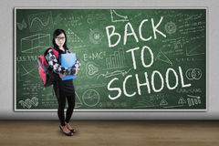 Student with doodles and text of Back to School Royalty Free Stock Photos