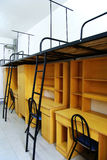 Student dorm. Bunk beds and cabinet in a student dorm Royalty Free Stock Image