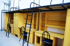 Student dorm. Bunk beds and cabinets in a student dorm Royalty Free Stock Photography