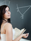 Student drawing on the chalkboard/blackboar Royalty Free Stock Photography
