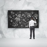 Student is drawing a flowchart on the chalkboard. Stock Photo