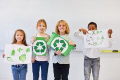 Student with drawings for recycling project. Student team of elementary school with drawings on ecology and recycling project stock photo