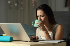 Student drinking and studying late hours in the night Stock Photos