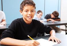 Student Eager to Learn. Handsome mixed-race student in class, ready to learn stock photos