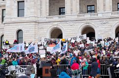 Student Embrace After Emotional Speech. Saint Paul, Minnesota, USA – MARCH 24, 2018: Students embrace each other following emotional speech at State Capitol Royalty Free Stock Image