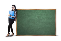 Student and empty blackboard Stock Photography