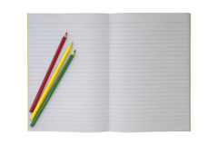 Student empty notebook with set of colorful pencils Stock Photos