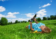 Student enjoying internet  in park Stock Image