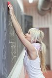 Student erasing the chalkboard Royalty Free Stock Photo