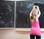 Student erasing the chalkboard/blackboard Stock Photography