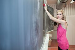 Student erasing the chalkboard/blackboard Royalty Free Stock Image