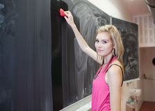Student erasing the chalkboard/blackboard Royalty Free Stock Images