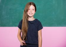 Student on exam. small girl pupil. happy school girl in classroom. back to school. forms of education. knowledge day is. 1st september. childhood happiness royalty free stock image