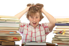 Student before exams. Student horrified with a huge amount of books to read Stock Images