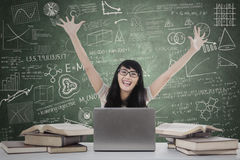 Student expressing happiness in the class Stock Photo
