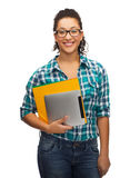 Student in eyeglasses with folders and tablet pc Royalty Free Stock Images