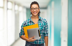 Student in eyeglasses with folders and tablet pc Stock Photography