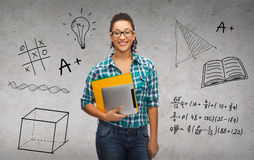 Student in eyeglasses with folders and tablet pc Royalty Free Stock Image