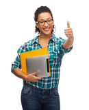 Student in eyeglasses with folders and tablet pc Stock Images