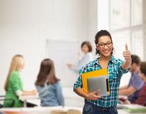 Student in eyeglasses with folders and tablet pc Royalty Free Stock Photography