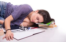 Student falling asleep on her books Stock Images