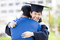 Student and family hug celebrating graduation royalty free stock photos