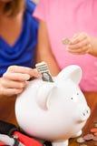 Student: Family Saving Money For Future Education Stock Image