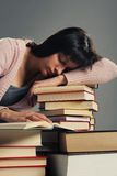 Student fell asleep on stack of book Stock Image