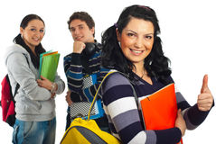 Student female with her colleagues. Happy student female giving thumb up and her colleagues smiling in background Stock Photography