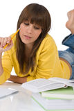 Student - female teenager write homework with book Royalty Free Stock Photo