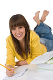 Student - female teenager write homework with book Royalty Free Stock Photography
