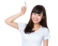 Student with finger showing upwards Royalty Free Stock Images
