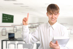 Student with finger up. Smiling pointing teenager with finger up Royalty Free Stock Photo