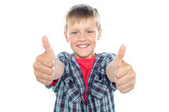 Student flashing double thumbs up. With his arms stretched out Royalty Free Stock Image