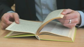 Student flipping the pages of the textbook stock footage