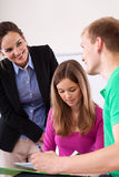 Student flirting with young teacher Royalty Free Stock Photo