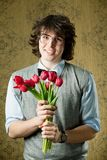 Student with flowers Royalty Free Stock Photo