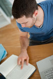 Student focuses on his book Royalty Free Stock Image